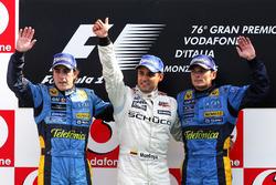 Podium: second place Fernando Alonso, Renault, third place Giancarlo Fisichella, Renault and race winner Juan Pablo Montoya, McLaren