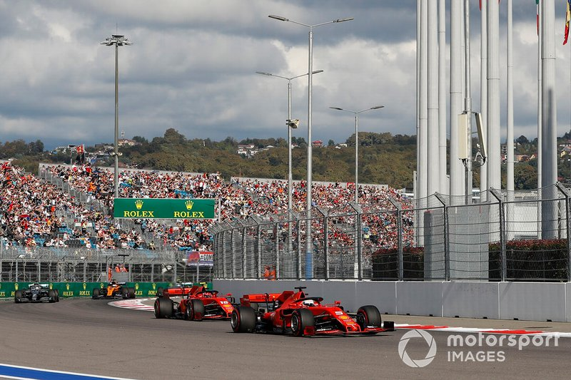 Sebastian Vettel, Ferrari SF90, leads Charles Leclerc, Ferrari SF90 Lewis Hamilton, Mercedes AMG F1 W10, Carlos Sainz Jr., McLaren MCL34 at the start