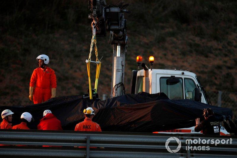 The car of Romain Grosjean, Haas F1 Team VF-19 is recovered