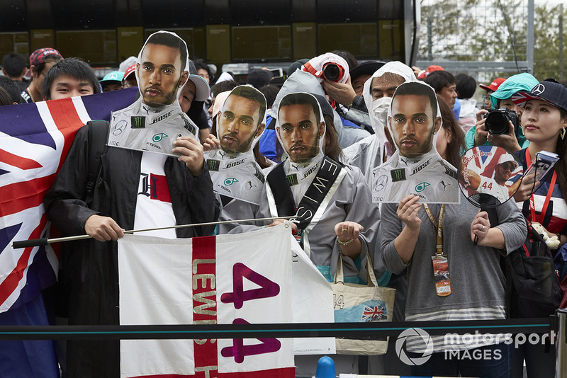 Fans with masks of Lewis Hamilton, Mercedes AMG F1