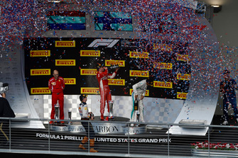 (L to R): Carlo Santi, Ferrari Race Engineer, Max Verstappen, Red Bull Racing, Kimi Raikkonen, Ferrari and Lewis Hamilton, Mercedes AMG F1 celebrate with the champagne on the podium