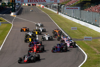 Romain Grosjean, Haas F1 Team VF-18, leads Sebastian Vettel, Ferrari SF71H, Pierre Gasly, Scuderia Toro Rosso STR13, Brendon Hartley, Toro Rosso STR13, Sergio Perez, Racing Point Force India VJM11, Esteban Ocon, Racing Point Force India VJM11, Carlos Sainz Jr., Renault Sport F1 Team R.S. 18, at the start of the race