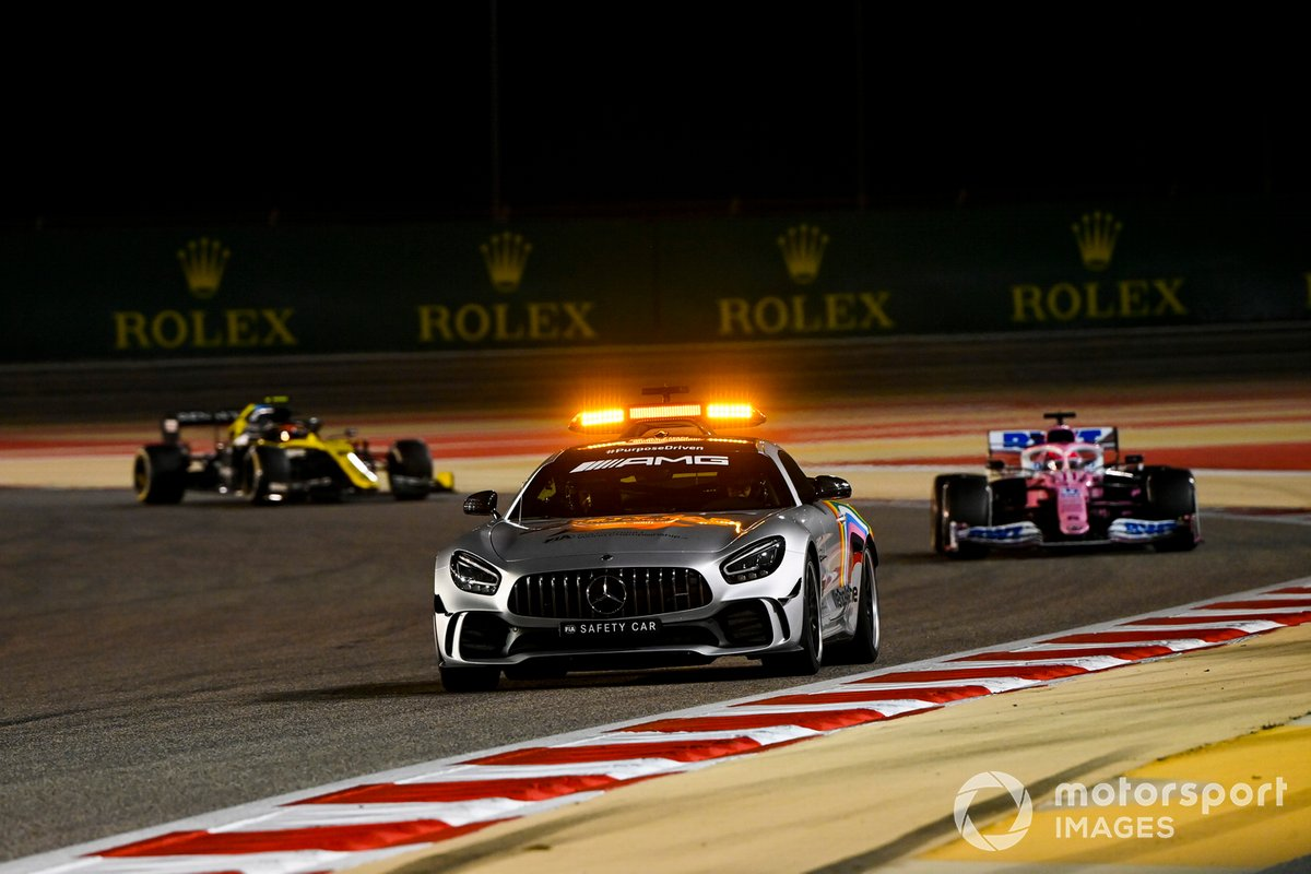 The Safety Car leads Sergio Perez, Racing Point RP20, and Esteban Ocon, Renault F1 Team R.S.20