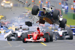 First corner accident: Ralf Schumacher, Williams flying over Rubens Barrichello, Ferrari