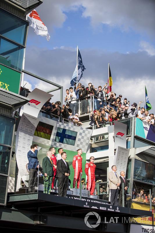 Inaki Rueda, Race Strategist, Ferrari, Lewis Hamilton, Mercedes AMG F1, 2nd position, Sebastian Vettel, Ferrari, 1st position, and Kimi Raikkonen, Ferrari, 3rd position, on the podium