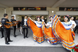 Mariachis and dancers outside the McLaren garage