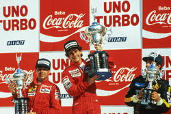 Podium: race winner Alain Prost, McLaren, second placed Michele Alboreto, Ferrari, third placed Elio De Angelis, Lotus