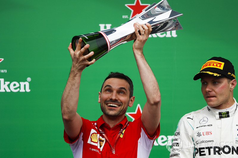 Nicola Bariselli, Race Engineer, Ferrari, lifts the constructors trophy alongside Valtteri Bottas, Mercedes AMG F1, 2nd position, on the podium