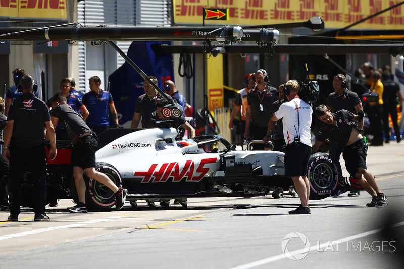 Romain Grosjean, Haas F1 Team, is pushed into his garage after his car started smoking in qualifying