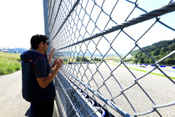Mark Webber watches as Marc Marquez, tests the Toro Rosso F1 car