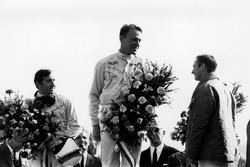 Dan Gurney, Eagle AAR104-Weslake, 1st position with Jackie Stewart, BRM P83, 2nd position and Chris Amon, Ferrari 312, 3rd position, on the podium