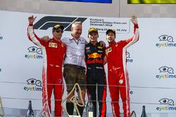 Kimi Raikkonen, Ferrari, 2nd position, Jonathan Wheatley, Team Manager, Red Bull Racing, Max Verstappen, Red Bull Racing, 1st position, and Sebastian Vettel, Ferrari, 3rd position, on the podium