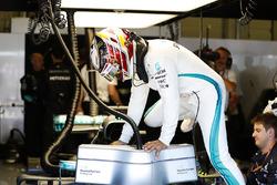 Lewis Hamilton, Mercedes AMG F1, climbs in to his car
