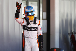 Fernando Alonso, McLaren, waves to his home fans after Qualifying