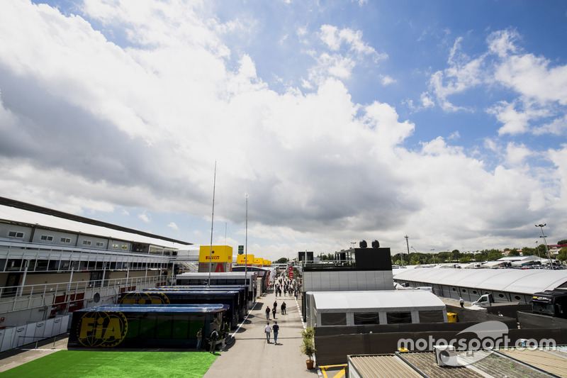 Motorhomes, trucks and hospitality units in a scenic view of the Barcelona paddock. The FIA motorhomes are in the foreground, along, the TV compound