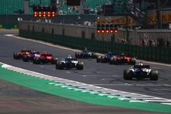Stoffel Vandoorne, McLaren MCL33, Valtteri Bottas, Mercedes AMG F1 W09, Sergio Perez, Force India VJM11, Kimi Raikkonen, Ferrari SF71H, Brendon Hartley, Toro Rosso STR13, Fernando Alonso, McLaren MCL33, Sergey Sirotkin, Williams FW41, and Lance Stroll, Williams FW41, line up for practice starts
