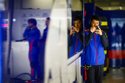 A Toro Rosso engineer using his phone