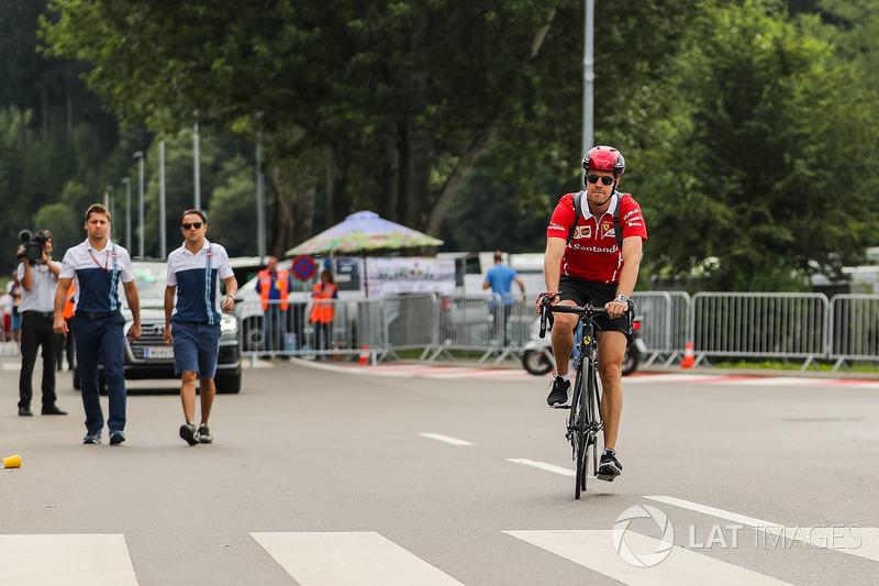 Sebastian Vettel, Ferrari rides a bicycle