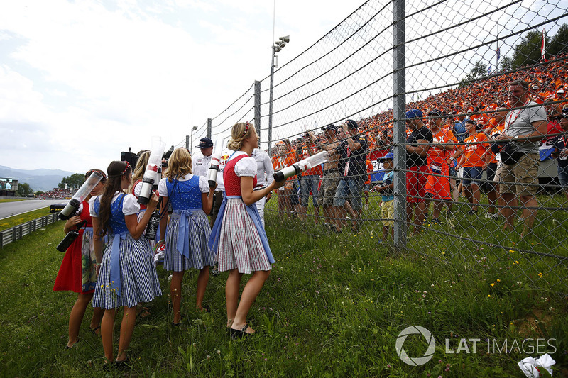 Promotional girls prepare to fire T-shirts over a safety-fence