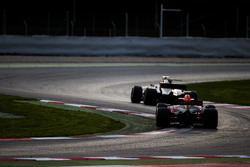 Romain Grosjean, Haas F1 Team VF-17, leads Max Verstappen, Red Bull Racing RB13