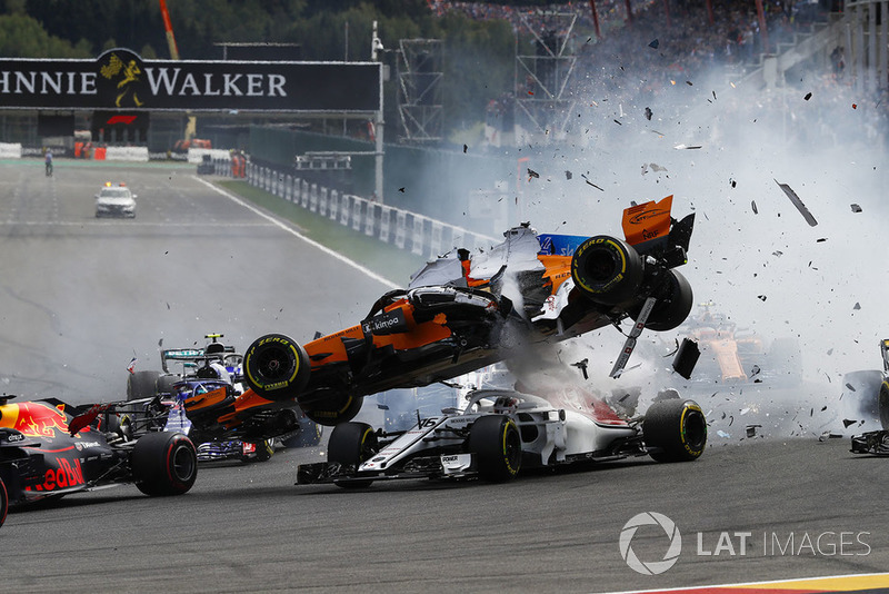 Fernando Alonso, McLaren MCL33, crashes over Charles Leclerc, Sauber C37, after contact from Nico Hulkenberg, Renault Sport F1 Team R.S. 18, at the start