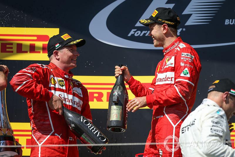 Podium: race winner Sebastian Vettel, Ferrari, second place Kimi Raikkonen, Ferrari