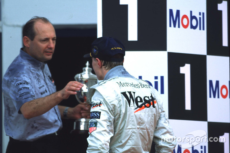 Mika Hakkinen and Ron Dennis celebrate Mika's first win