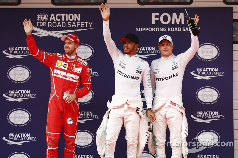 Top three qualifiers Lewis Hamilton, Mercedes AMG, Sebastian Vettel, Ferrari, and Valtteri Bottas, Mercedes AMG