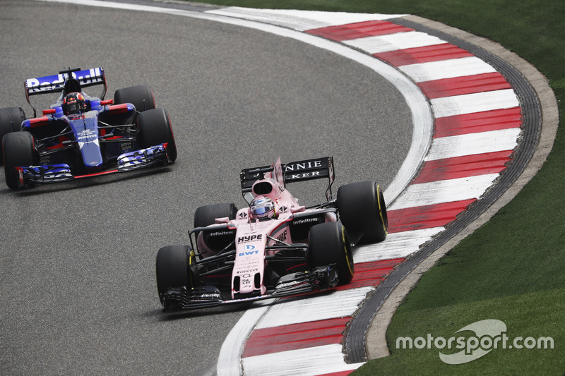 Sergio Perez, Force India VJM10, leads Daniil Kvyat, Scuderia Toro Rosso STR12