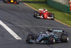 Valtteri Bottas, Mercedes AMG F1 W08, leads Kimi Raikkonen, Ferrari SF70H, and Max Verstappen, Red Bull Racing RB13