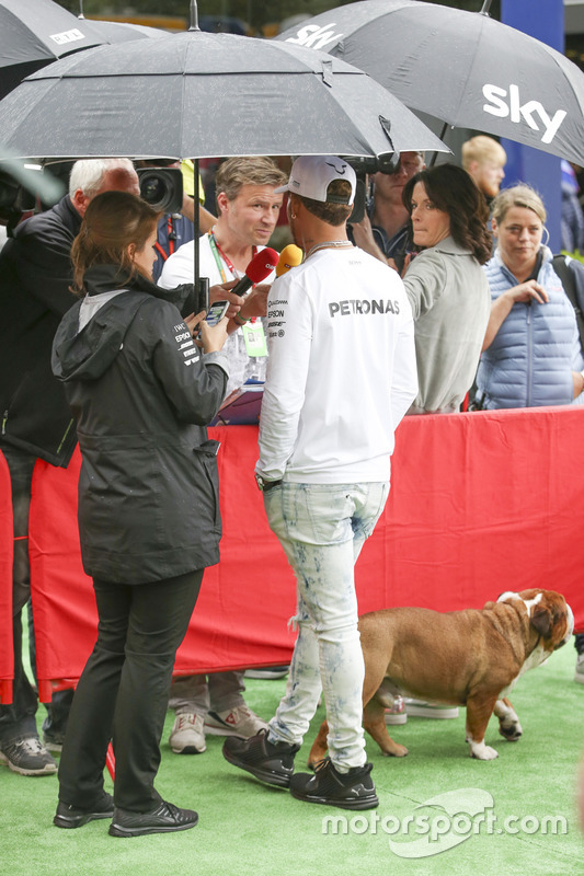 Lewis Hamilton, Mercedes AMG F1, speaks to media, while accompanied by his dog