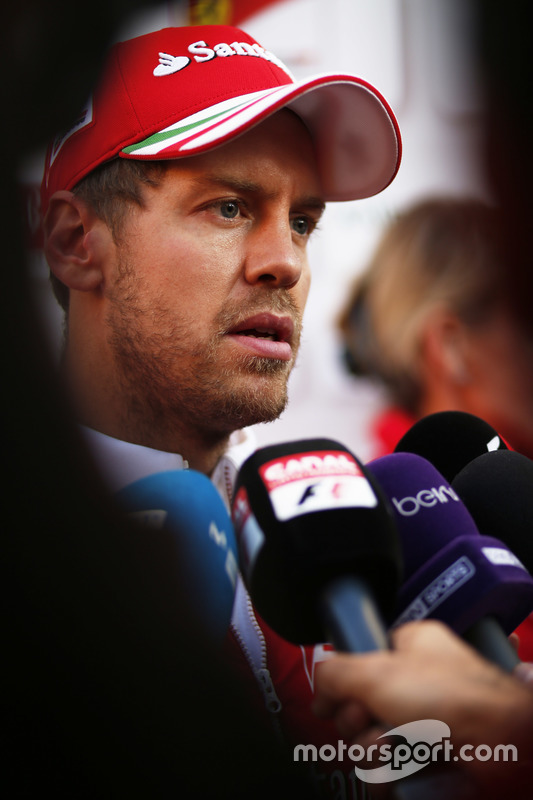 Sebastian Vettel, Ferrari, talks to the media