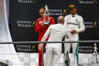 Lewis Hamilton, Mercedes AMG F1, is congratulated on the podium