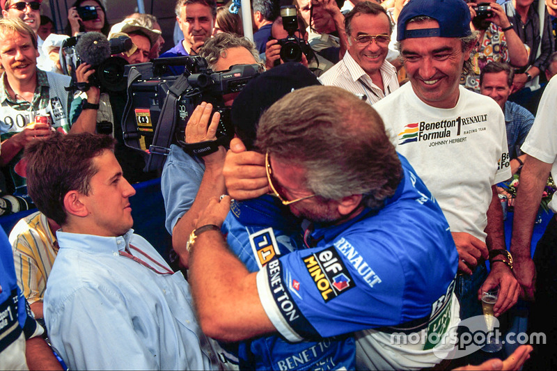Race winner Micheal Schumacher, Benetton, celebrates with his manager Willi Weber and Flavio Briatore