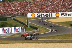 Damon Hill, Arrows A18 Yamaha, Eddie Irvine, Ferrari F310B and Mika Hakkinen, McLaren MP4/12 Mercedes