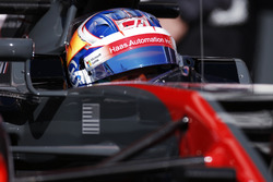 Romain Grosjean, Haas F1 Team, in cockpit with helmet visor raised