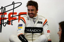 Fernando Alonso, McLaren, relaxes in the garage