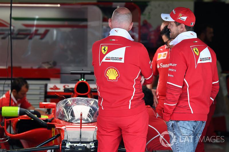 Sebastian Vettel, Ferrari looks at Ferrari SF70H with cockpit shield