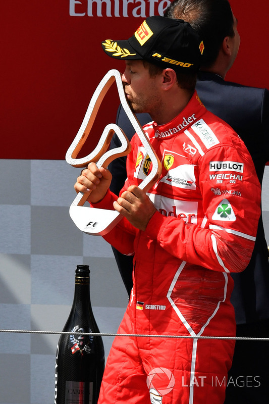 Second place Sebastian Vettel, Ferrari celebrates on the podium