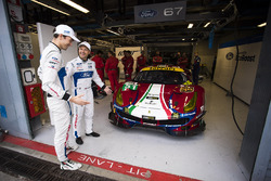 Andy Priaulx, Harry Tincknell, Ford Chip Ganassi Racing, looking at the car #51 AF Corse Ferrari 488 GTE in their garage spot