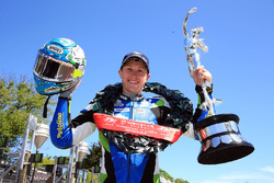 Dean Harrison, celebrates winning the 2nd Supersport race
