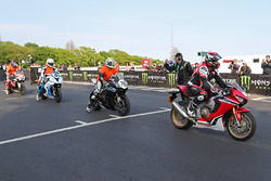 Isle of Man TT Rider Liaison officer Richard Milky Quayle gets proceedings underway by taking the Newcomers on their speed-controlled lap of the Mountain Course