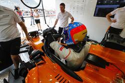 Fernando Alonso, McLaren, climbs in to his car