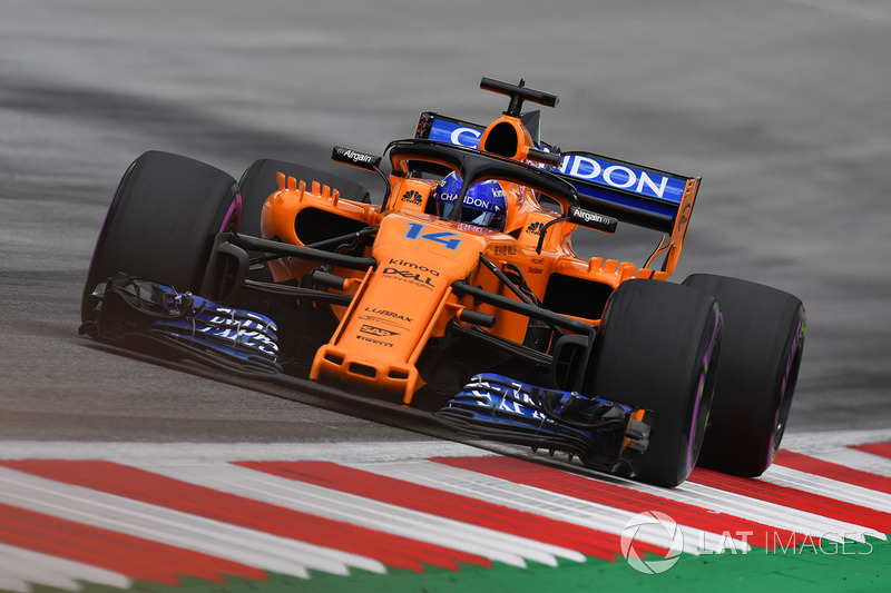 Alonso complains about being stuck in the rear end of the pack