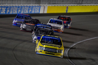 Grant Enfinger, ThorSport Racing, Ford F-150 leads a pack of trucks