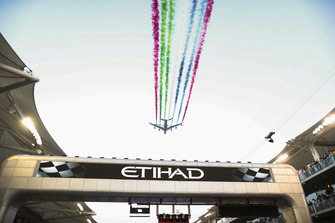 UAE display team Al Fursan escort an Airbus A380 of Etihad Airlines over the grid in their Aermacchi MB339A aircraft