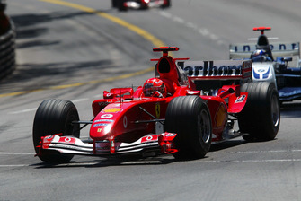 Михаэль Шумахер, Ferrari F2004, и Хуан-Пабло Монтойя, Williams BMW FW26
