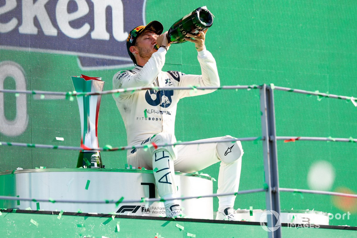 Pierre Gasly, AlphaTauri, 1st position, drinks Champagne on the podium