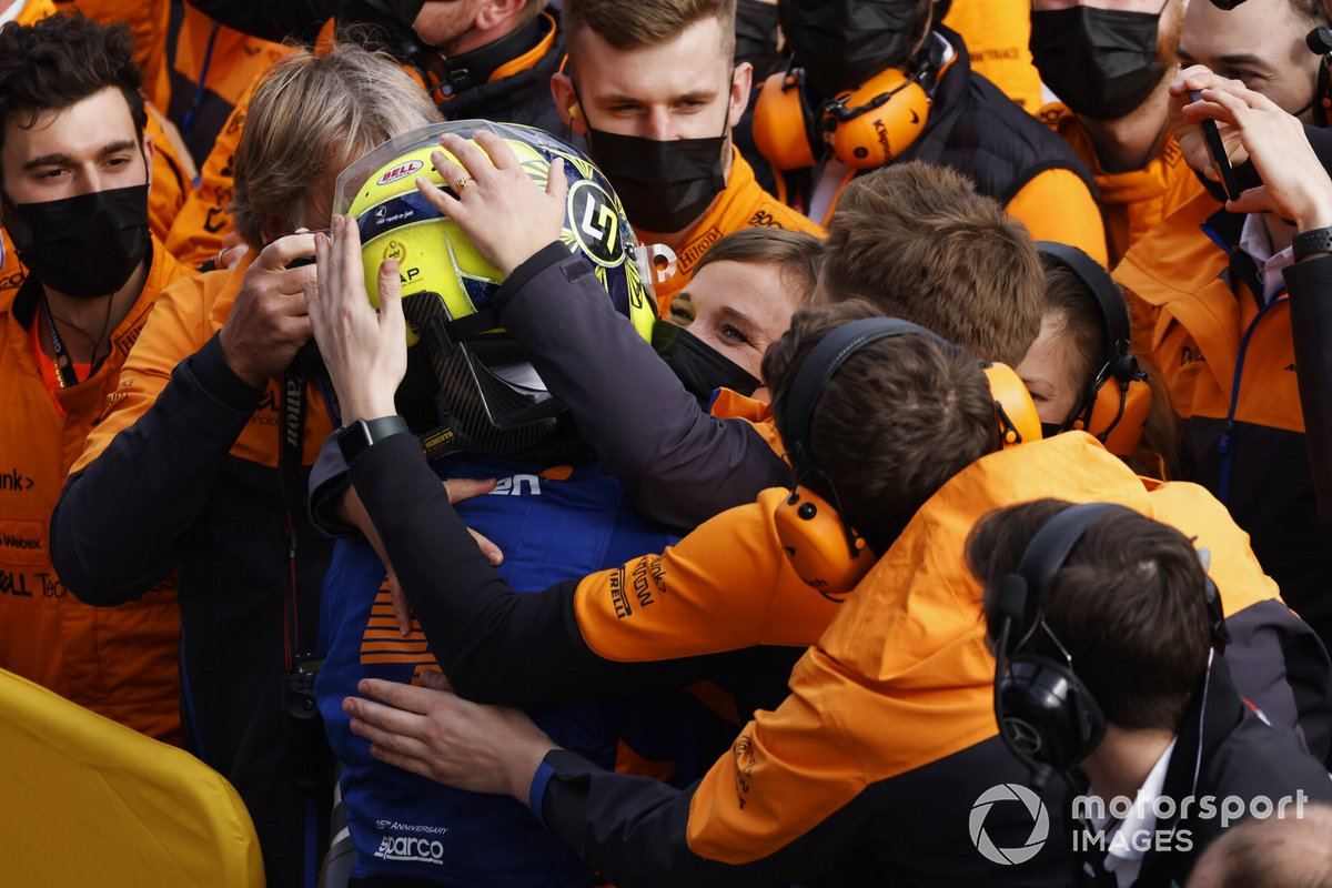 Members of the McLaren team congratulate Lando Norris, McLaren, 3rd position, in Parc Ferme