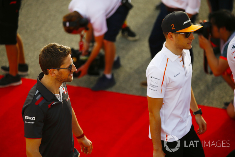 Stoffel Vandoorne, McLaren, and Romain Grosjean, Haas F1 Team, in the drivers parade